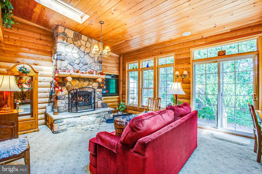 covered porch with a fireplace - 5060 LAVELLE DR, FREDERICKSBURG