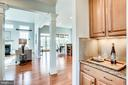 Butler Pantry transitions to Kitchen & Great Room - 20353 TANAGER PL, LEESBURG