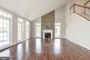 Family Room with fireplace off Kitchen - 14300 DOWDEN DOWNS DR, HAYMARKET