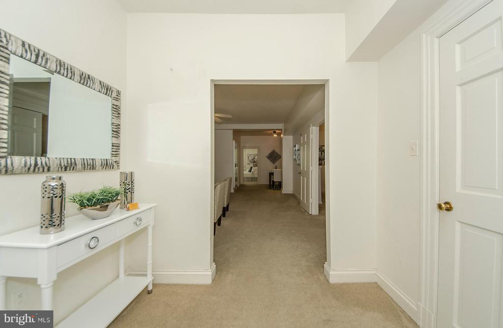 Foyer opens to living room - 3100 CONNECTICUT AVE NW #229, WASHINGTON