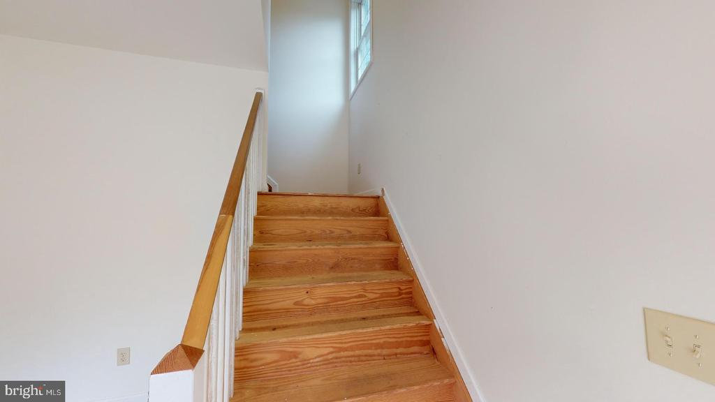 Stairs to Living Area Above Garage - 1208 SPOTSWOOD DR, LOCUST GROVE