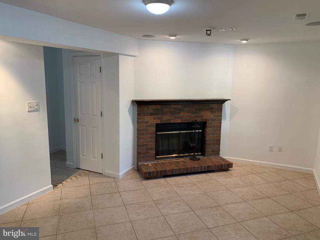 Family Room Wood Fireplace - 21906 GREENTREE TER, STERLING