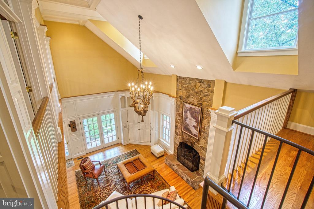 View top of circular stairs to family room below - 3812 MILITARY RD, ARLINGTON