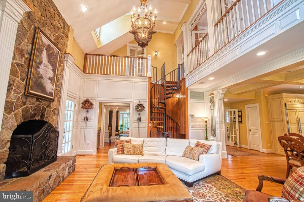 Stone gas fireplace and custom circular stairs - 3812 MILITARY RD, ARLINGTON