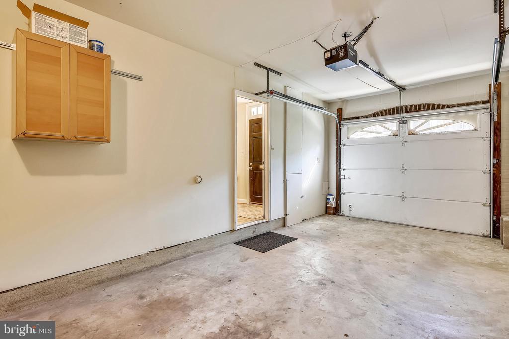 Long garage with electric door opener. - 102 ROBERTS CT, ALEXANDRIA