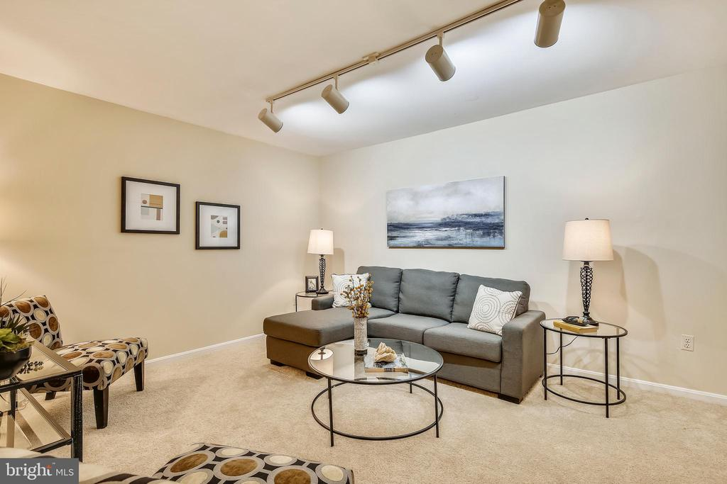 Family/media room/office with a large closet. - 102 ROBERTS CT, ALEXANDRIA