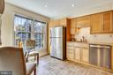 Bright and airy eat-in kitchen. - 102 ROBERTS CT, ALEXANDRIA