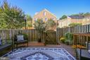 Sunny patio with street parking behind. - 102 ROBERTS CT, ALEXANDRIA