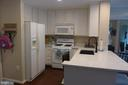 Kitchen with eat-in counter-top space - 11872 BRETON CT #12A, RESTON