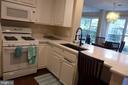 Kitchen overlooking at dining area - 11872 BRETON CT #12A, RESTON