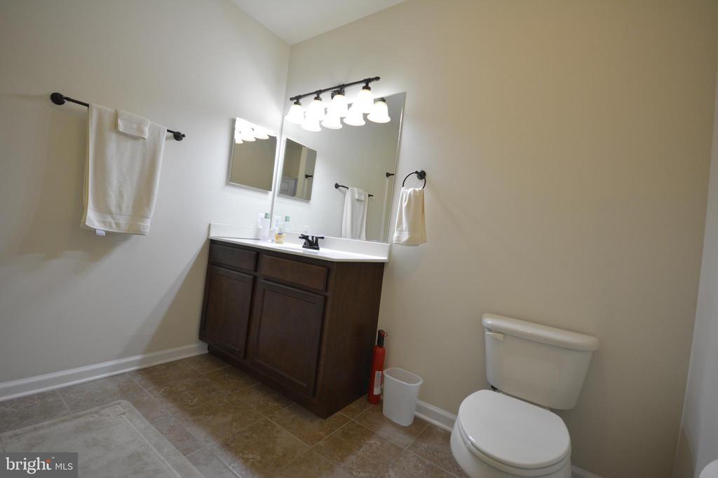The full bathroom in the basement. - 38 PRESIDENTIAL LN, STAFFORD