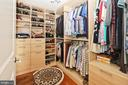 A customized walk-in closet in the master suite - 11990 MARKET ST #1914, RESTON
