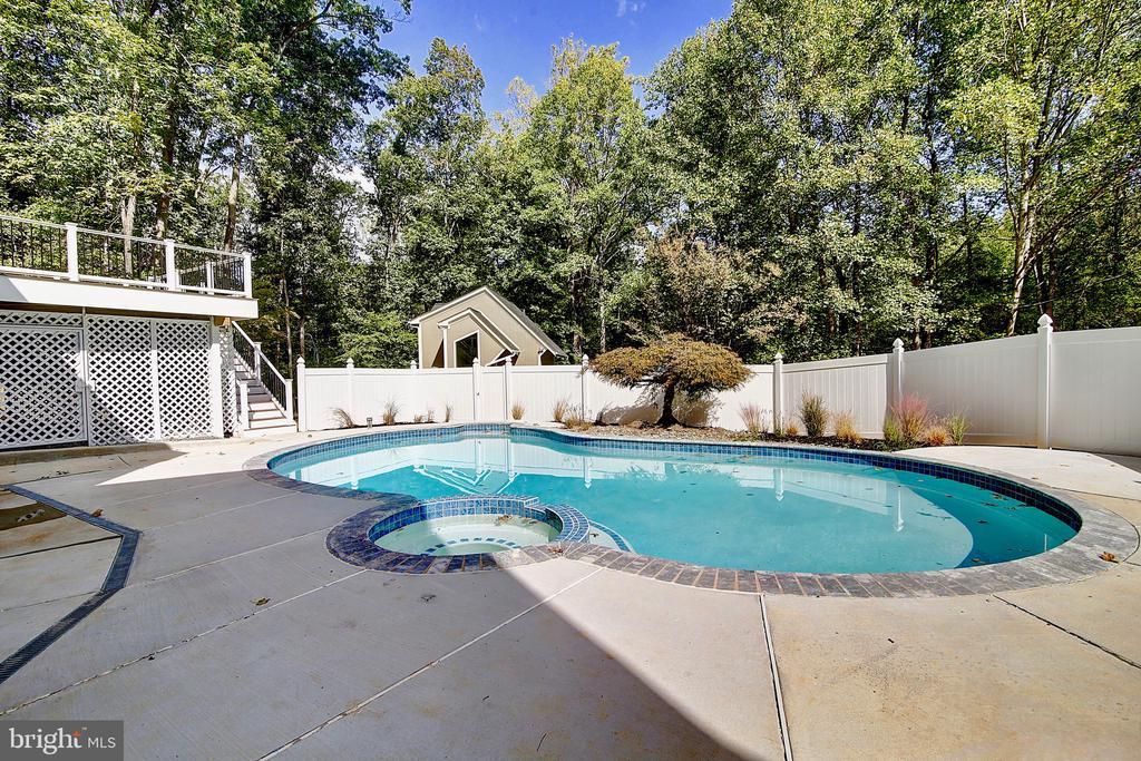 Pool area off of deck and basement level entry - 10614 HUNTER STATION RD, VIENNA