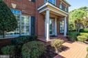 Inviting portico over front door - 7002 HIGHLAND MEADOWS CT, ALEXANDRIA
