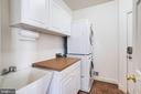 Laundry/Mud room w/ storage & sink - 7002 HIGHLAND MEADOWS CT, ALEXANDRIA