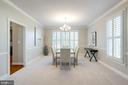 Dining room with new chandelier & plenty of light - 7002 HIGHLAND MEADOWS CT, ALEXANDRIA