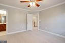 Second bedroom w/ walk in closet & ceiling fan - 7002 HIGHLAND MEADOWS CT, ALEXANDRIA