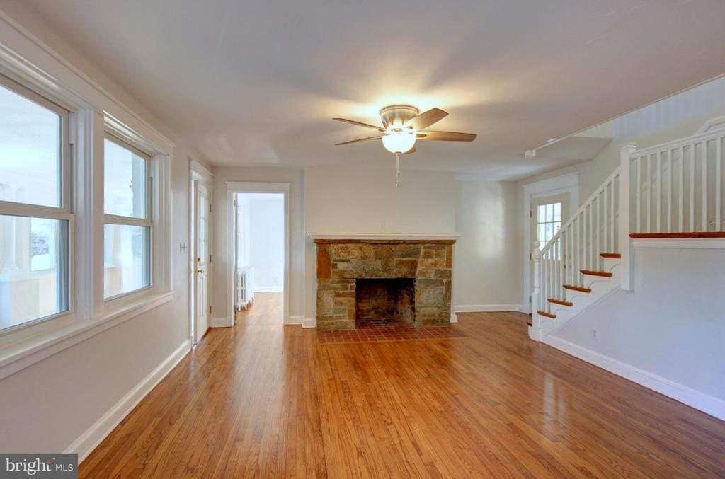Beautiful stone mantel in the living room. - 6612 BALTIMORE AVE, UNIVERSITY PARK
