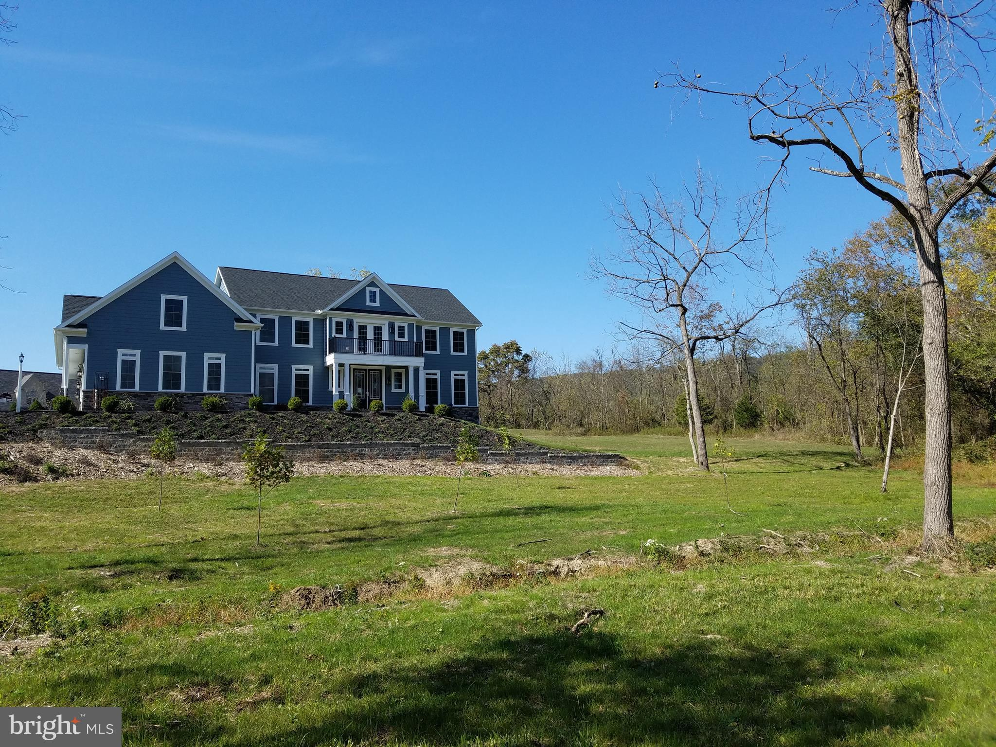 Private setting on 2.57 acres with stream.