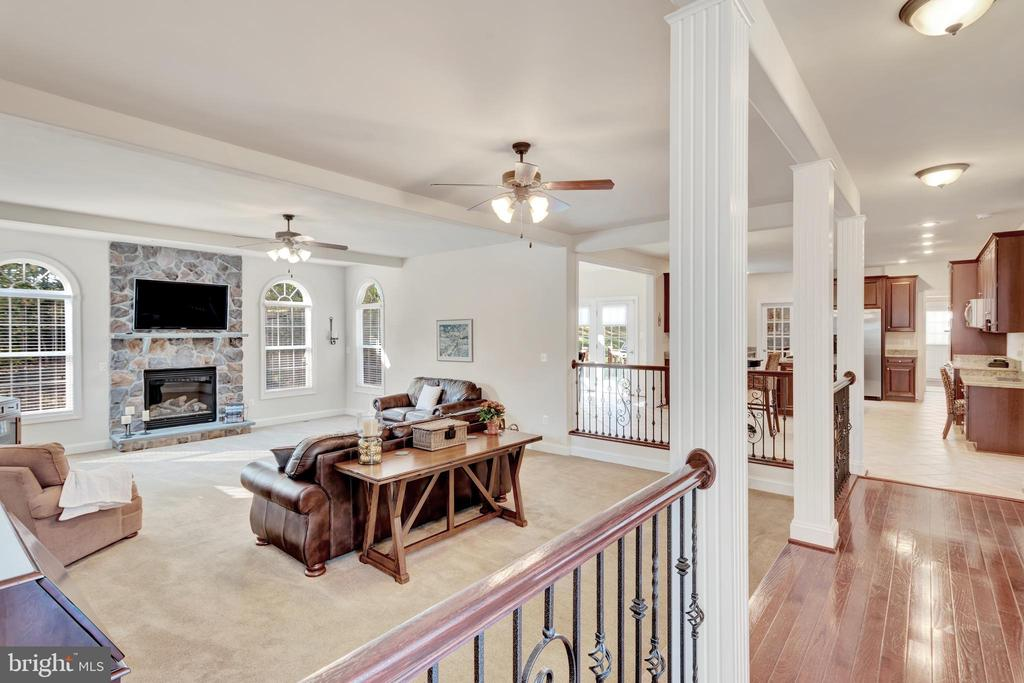 Family room with gas fireplace and television. - 38 PRESIDENTIAL LN, STAFFORD