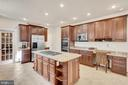 The kitchen has level 3 cherry cabinets. - 38 PRESIDENTIAL LN, STAFFORD