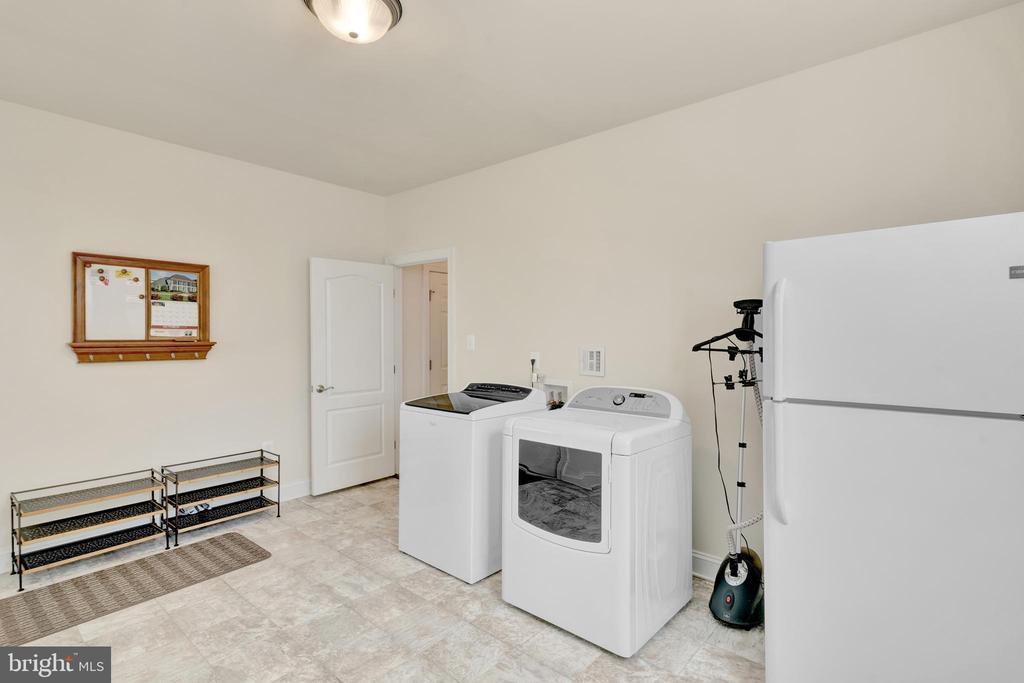 Mud room next to kitchen. 11'-6