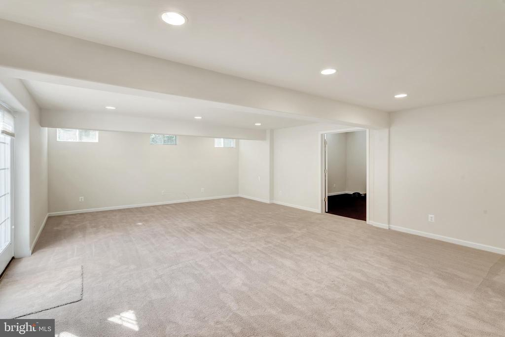 The room in the background is a exercise room. - 38 PRESIDENTIAL LN, STAFFORD