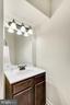 Half bathroom in the basement media room. - 38 PRESIDENTIAL LN, STAFFORD