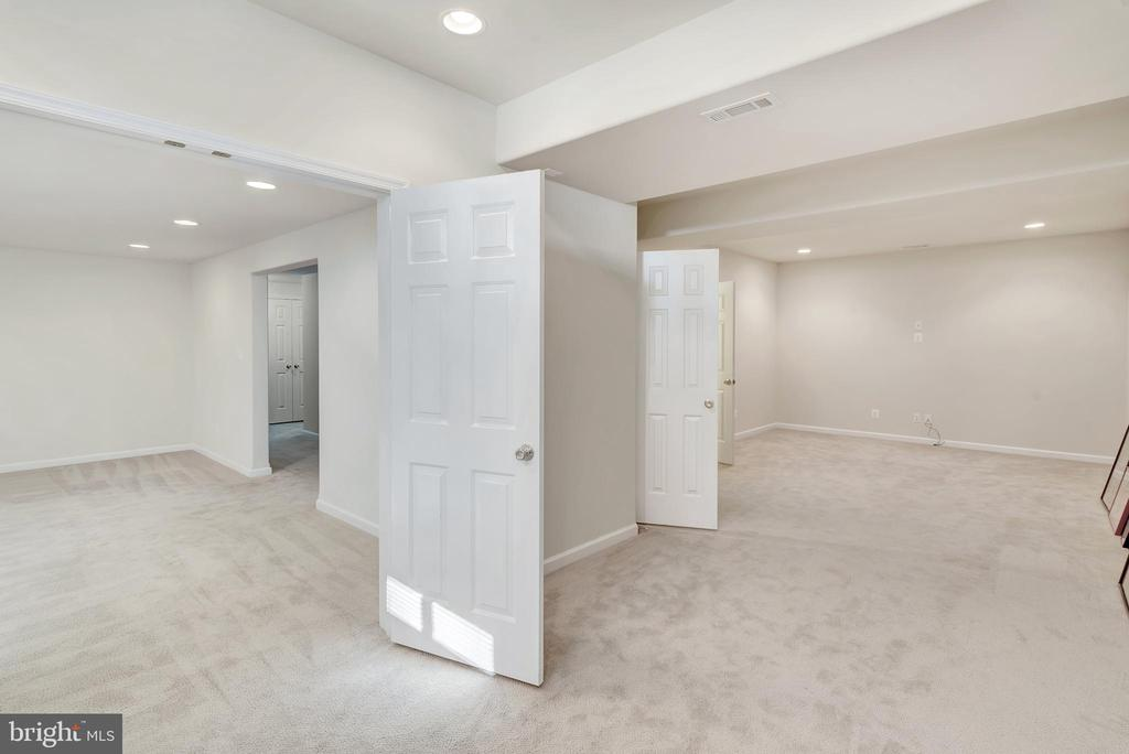 Basement recreation room (left) media room (right) - 38 PRESIDENTIAL LN, STAFFORD