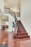 Split staircase in living room and kitchen. - 38 PRESIDENTIAL LN, STAFFORD