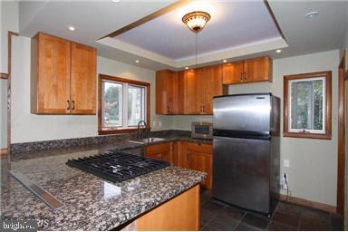 Updated kitchen with granite counter tops. - 235 N BARTON ST, ARLINGTON