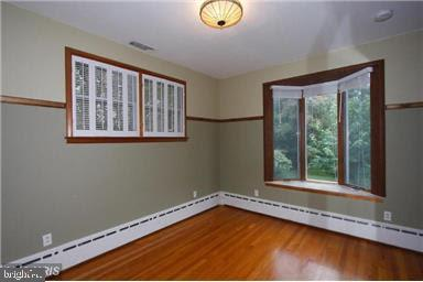 Hardwoods throughout entire first floor. - 235 N BARTON ST, ARLINGTON