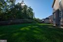The backyards of neighboring lots. - 38 PRESIDENTIAL LN, STAFFORD