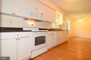 KITCHEN OPEN TO CASUAL DINING AREA - 10215 HUNTER VALLEY RD, VIENNA