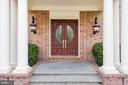 Double mahogany-stained doors at the entrance - 3057 RUNDELAC RD, ANNAPOLIS