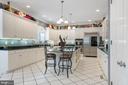 Kitchen has a breakfast bar at center island - 3057 RUNDELAC RD, ANNAPOLIS