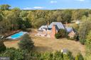 There is a four acre lot with an in-ground pool - 3057 RUNDELAC RD, ANNAPOLIS
