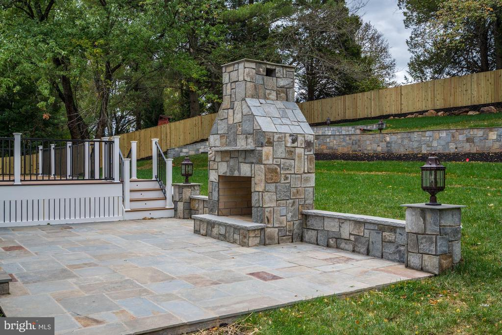 Flagstone patio with wood burning fireplace - 932 DEAD RUN DR, MCLEAN