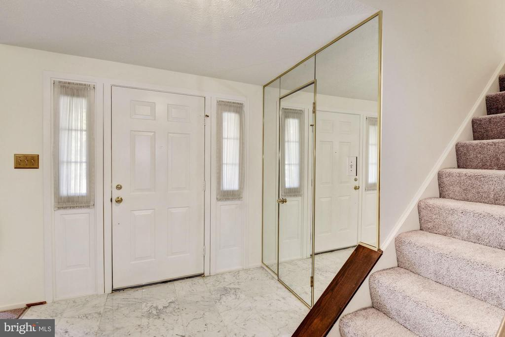 Marble foyer and mirrored powder room wall. - 1209 GOTH LN, SILVER SPRING