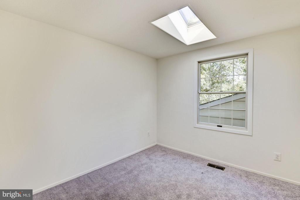 Bedroom #2 with skylight. - 1209 GOTH LN, SILVER SPRING