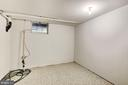 Lower level utility room with sump pump. - 1209 GOTH LN, SILVER SPRING
