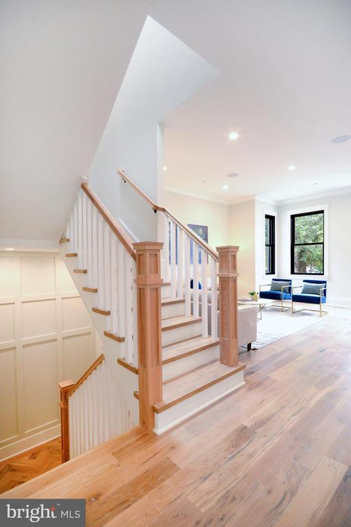 Central stairs with wainscot casework - 1432 1/2 G ST SE, WASHINGTON