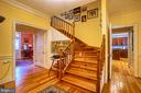 Main staircase leading to 2nd floor landing - 20 NORTH ST NW, LEESBURG