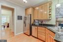 Kitchen with panty and access to garage - 8240 EDGEWOOD CHURCH RD, FREDERICK