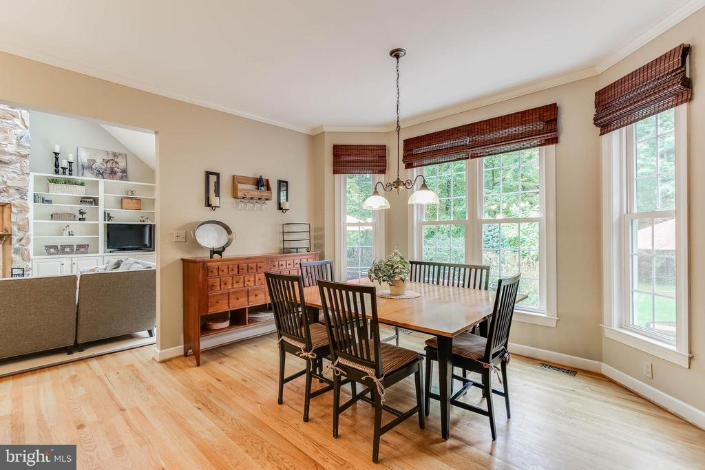 Large windows overlooking side yard and patio - 8240 EDGEWOOD CHURCH RD, FREDERICK