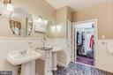 Master bathroom, two sinks, walk in closet - 8240 EDGEWOOD CHURCH RD, FREDERICK