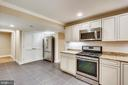 Lower level kitchen with laundry room - 315 SCOTT DR, SILVER SPRING