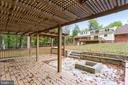 View of pergola and firepit with seating - 315 SCOTT DR, SILVER SPRING