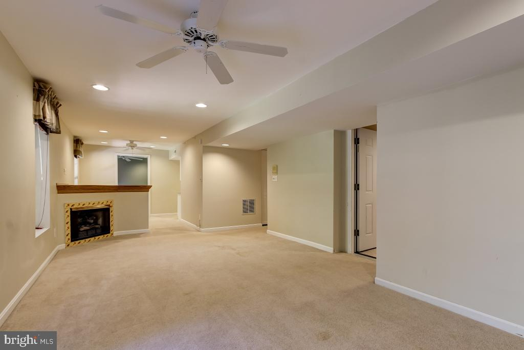 RecRoom  with Gas fireplace - 9224 MATTHEW DR, MANASSAS PARK