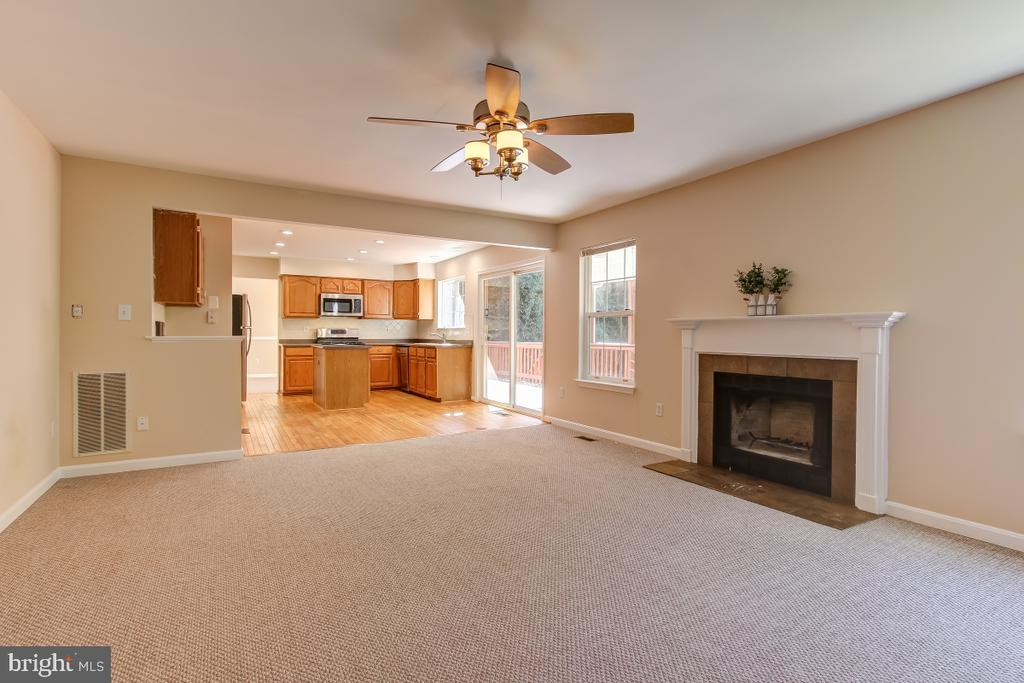 Family room with wood burning fireplace - 9224 MATTHEW DR, MANASSAS PARK